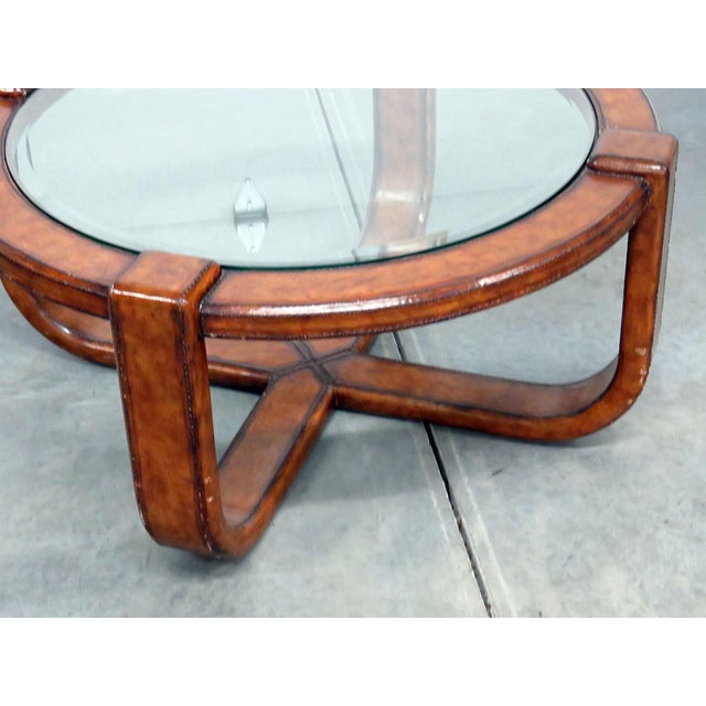 Mid-Century Modern design wrapped coffee table with a beveled glass top.