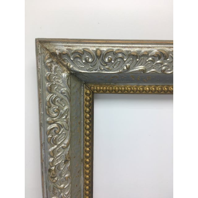 This lovely vintage frame is nicely painted in both soft gold and silver. Probably originally brown, the creative owner of...