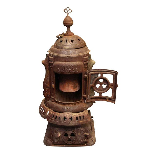 Ornate cast iron stove by Oak Bengal. Manufactured by The Floyd Wells Co.