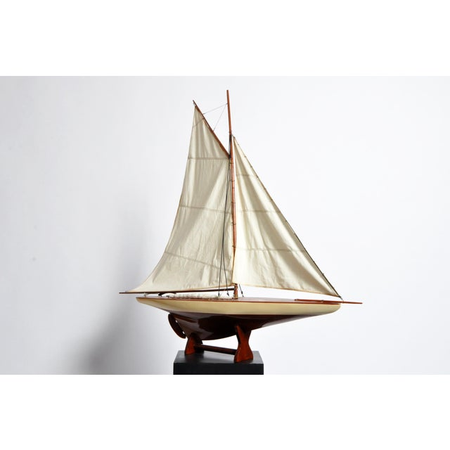 This handsome American pond boat is from the U.S and is made from wood and lacquer.