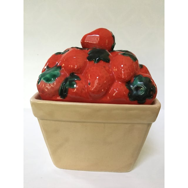 Vintage, fun trompe l'oeil canister/sweets jar that looks like a pint of fresh, red strawberries with green stems. Handle...