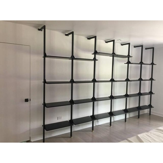 Rare Industrial wall-mounted library or shelving system that is completely customize-able to your design needs. A long...
