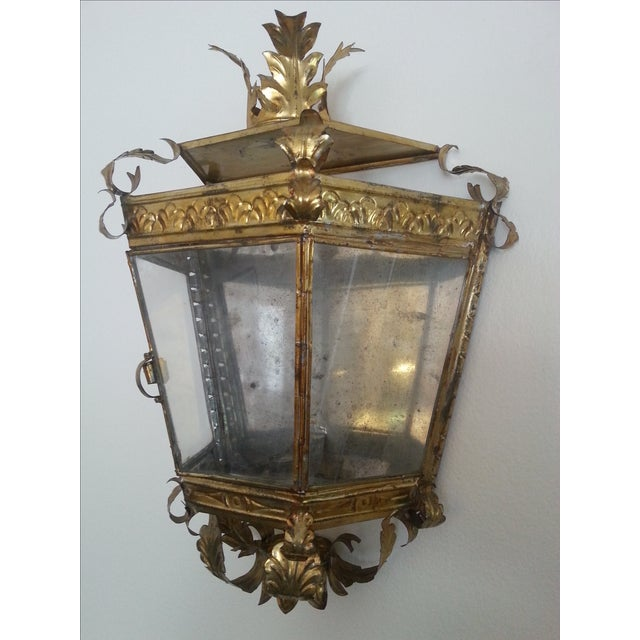 This unusual Italian candle sconce has glass on three sides and a reflective metal surface on the back. The decorations...