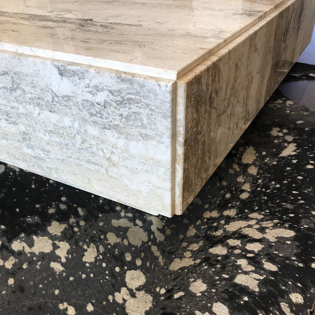 Beautiful travertine cocktail table in tones of gray, cream and beige. Be sure to take a look at the detail, This is a...