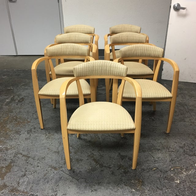 A set of seven mid-century modern light maple Lowenstein dining chairs. The chairs can be used in the dining room and...