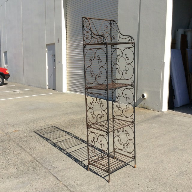 Versatile scrolling iron etagere, great for indoor or outdoor use. It can be used for towels in a bathroom, books in an...