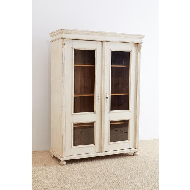 Gorgeous painted pine bibliotheque bookcase or linen press made in the neoclassical Swedish Gustavian style. Features a...