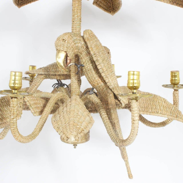 Mario Torres midcentury 6-light chandelier constructed of an iron frame wrapped with wicker or reed in an intricate tight...
