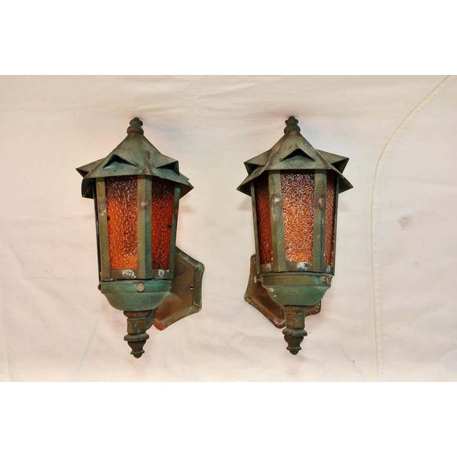 A rare pair of 1920s copper outdoor sconces, the patina is much nicer in person.