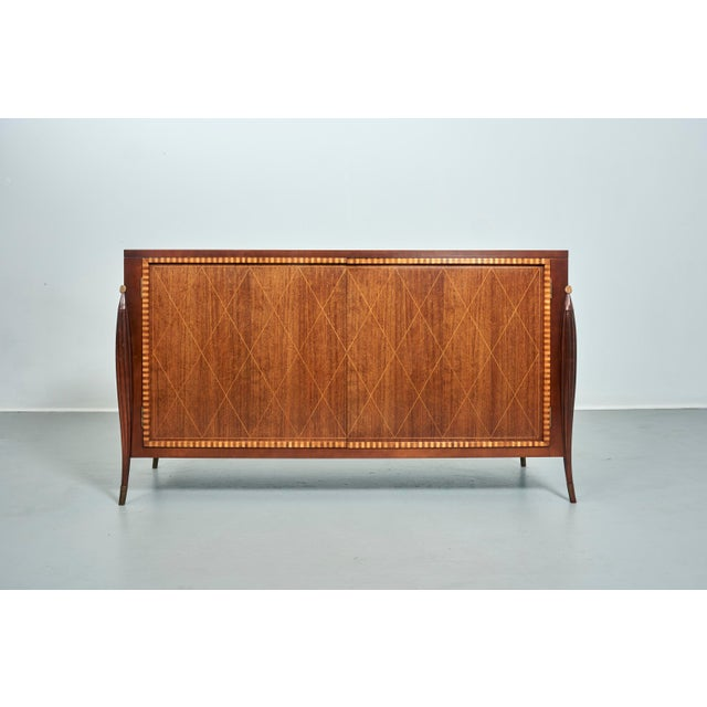 Two Door Credenza by Baker Furniture Made in , circa 1980's Two interior drawers, one felt-lined cutelery drawer, one...
