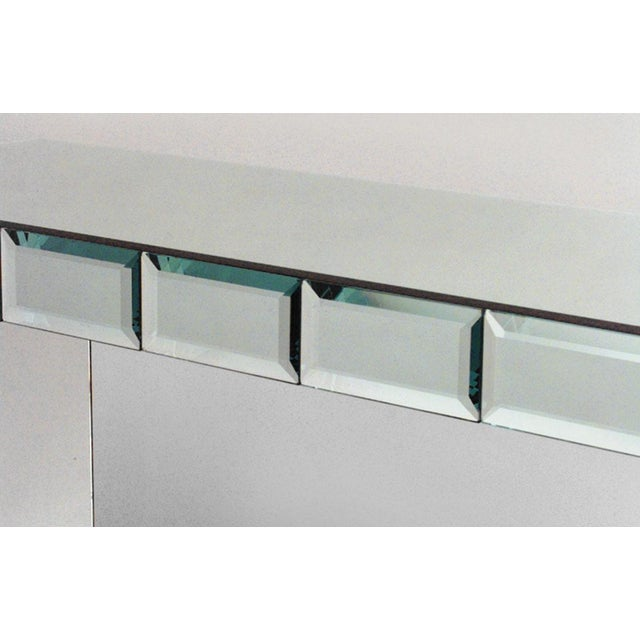 French Art Moderne mirrored rectangular console table with bevelled paneled apron and front legs.