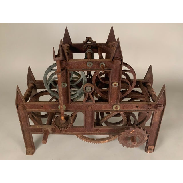 A large and intricate antique 19th century cast iron clockworks from a clock tower. Beautiful gothic design filled with...