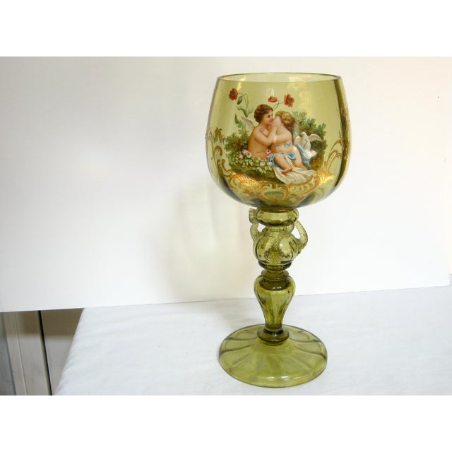 Outstanding antique hand painted blown glass decorative tall loving chalice with a whimsical scene of two cherubs...
