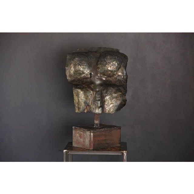 Brutalist bronze sculpture of a female torso, circa 1960s, unsigned.