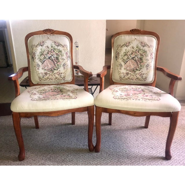 French Provincial Tapestry salon chairs have lovely carved wood detailing with charming vintage needlework print depicting...