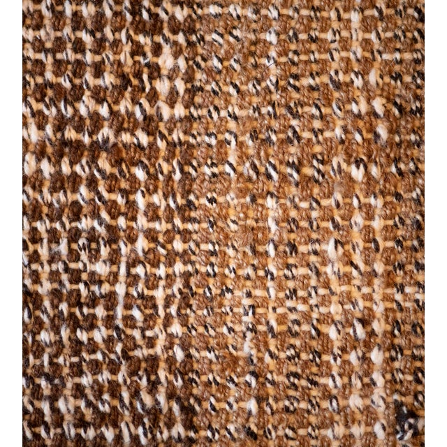 This Turkish Style flatweave rug has a tobacco-brown field woven in horizontal shaded bands of tobacco-brown shades, the...