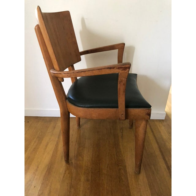 Beautiful Heywood Wakefield arm chair. Has wonderful rich original patina and perfect oil cloth seat in dark green. Would...