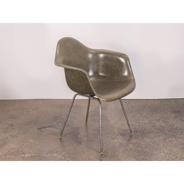 Vintage Eames molded fiberglass armchair in the scarce, olive green hue on a the nickel H-base for Herman Miller. Original...