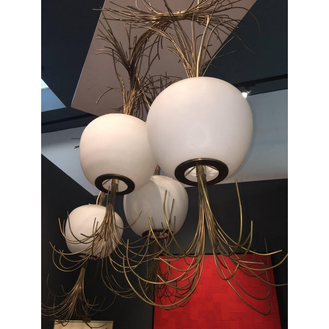 Consisting of four brass trimmed Murano Opaline glass globes with a profusion of thick brass filaments riotously emanating...