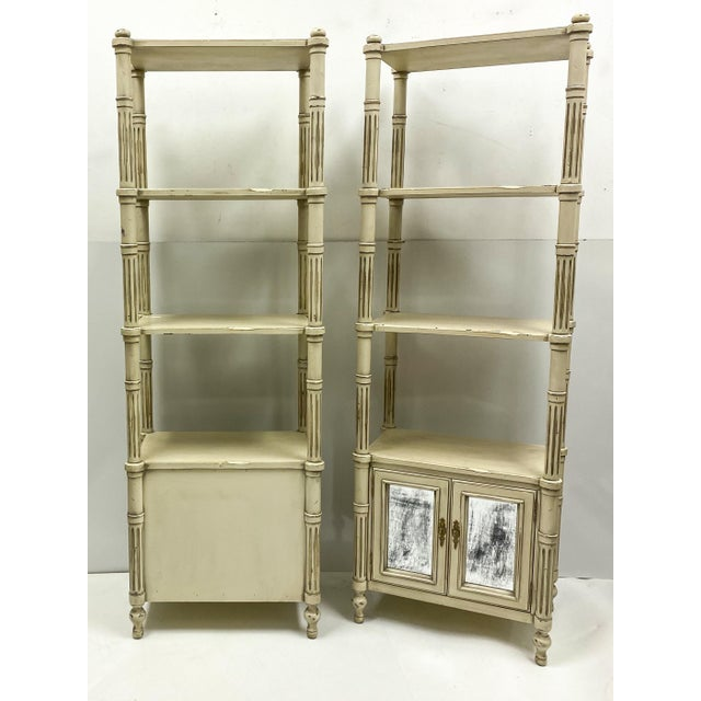 This is a pair of late 20th century Gustavian style etageres in very good condition. The doors have intentionally...