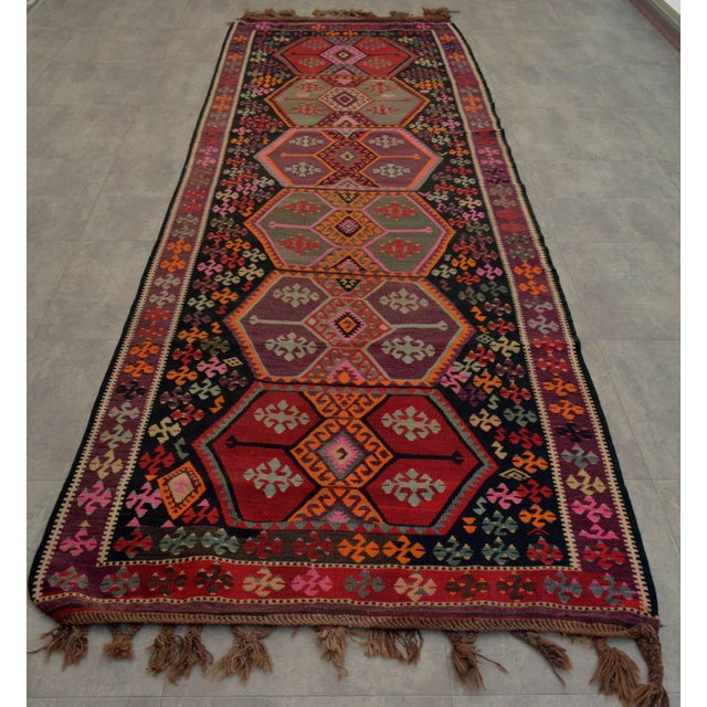 This vintage Anatolian kilim is comprised of Wool on wool. Brown, Gray, white and black colours are not dyes. Original...