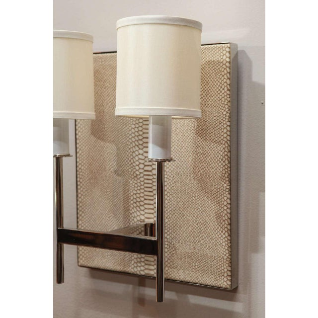 Paul Marra Two-Arm Sconce with faux python back. Shown in polished nickel and vanilla silk pongee shades. One in stock, or...