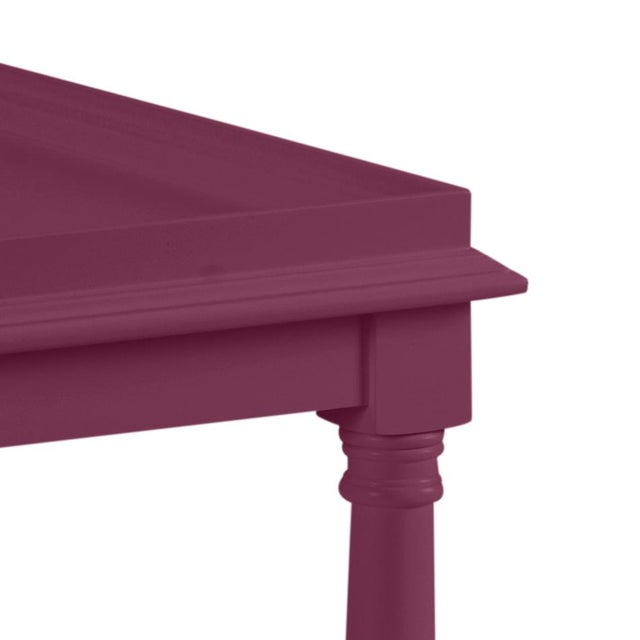 This acacia wood side table features a single shelf and turned legs. The color is Benjamin Moore Grape Juice with a semi-...