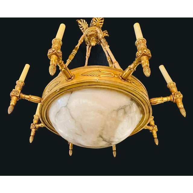19th-20th century alabaster and giltwood chandelier. A stunning neoclassical chandelier having a large domed alabaster...
