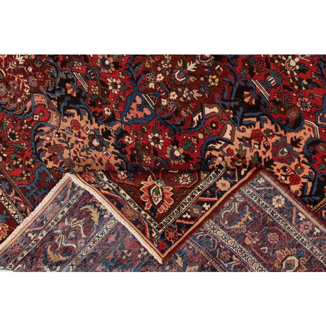 A hand-knotted antique Bakhtiari rug with a floral design. This piece has great detailing and colors. It would be the...