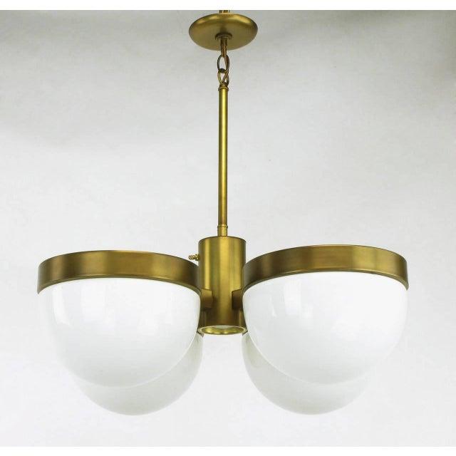 Feldman lighting of California brass and milk glass orbital four half moon shade pendant or chandelier. Bronze finished...