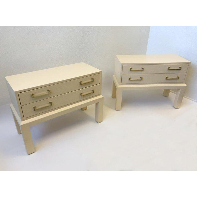 A spectacular 1980s pair of two-drawer nightstands by Steve Chase. The nightstand are constructed of wood covered with...