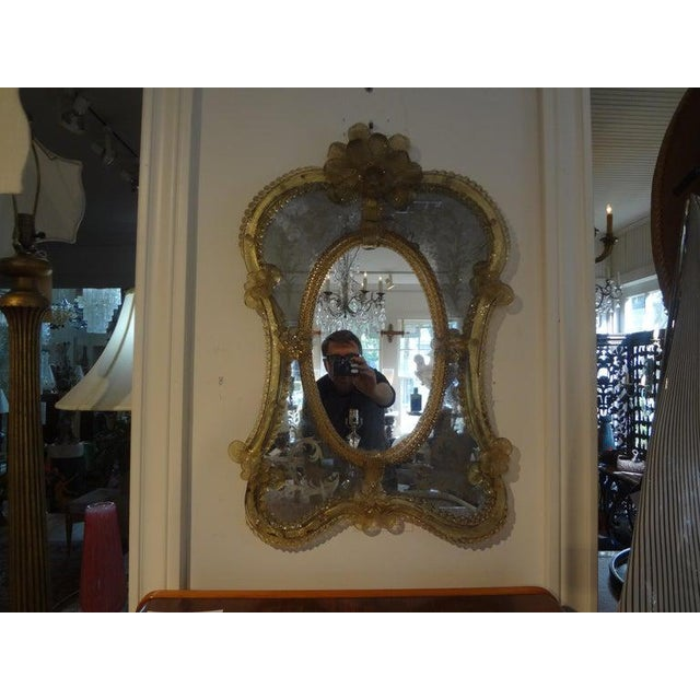 Stunning Italian Venetian glass mirror with beautiful etching. No cracks, only naturally occurring foxing. Our Venetian...