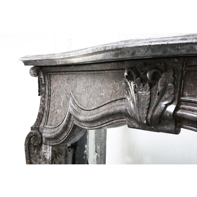 Very nice elegant and robust fireplace of marble. An antique fireplace from the 19th century from the time of Louis XV....