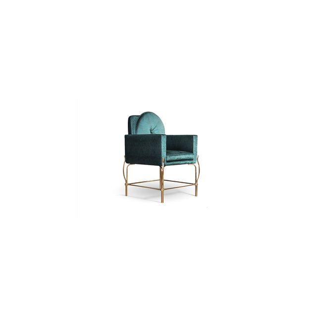 Hollywood Regency is brought to life with this fabulous dinning or desk chair. The sculptural metal base gives us a hint...