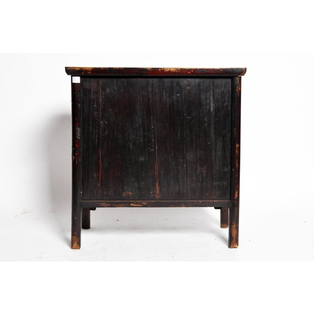 This rustic chest is from Shanxi, China and was made from elm wood c. Early-Qing Dynasty. The piece features a pair of...