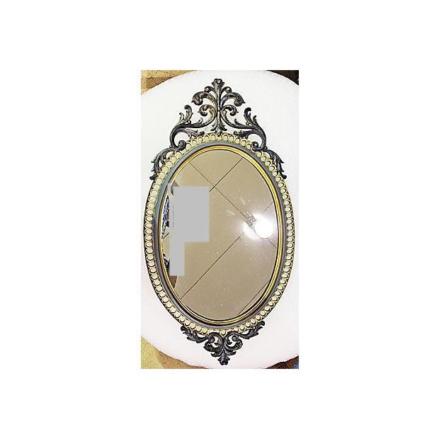 Ornate Hollywood Regency rococo resin oval mirror just finished in Annie Sloan paint and French gilding wax. Dated 1971.