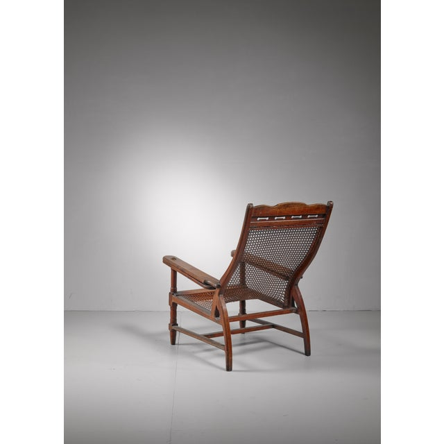 Planter's chair in teak, cane and brass, Italy, circa 1900 For Sale - Image 4 of 8