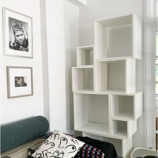 Design your own bookcase with this clever, modular bookcase/wall unit by Seletti. Glossy white painted MDF modules nest...