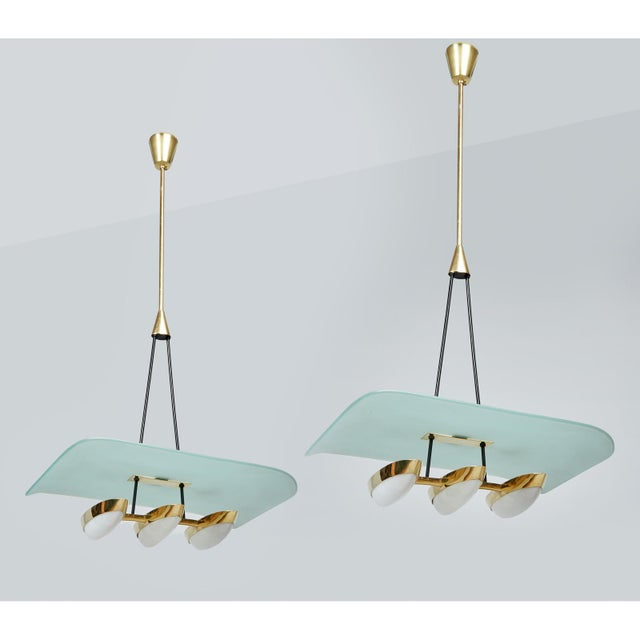 Angelo Lelii (1915 - 1979) A lovely pair of pendant chandeliers by Angelo Lelii (sometimes spelled Angelo Lelli) for...
