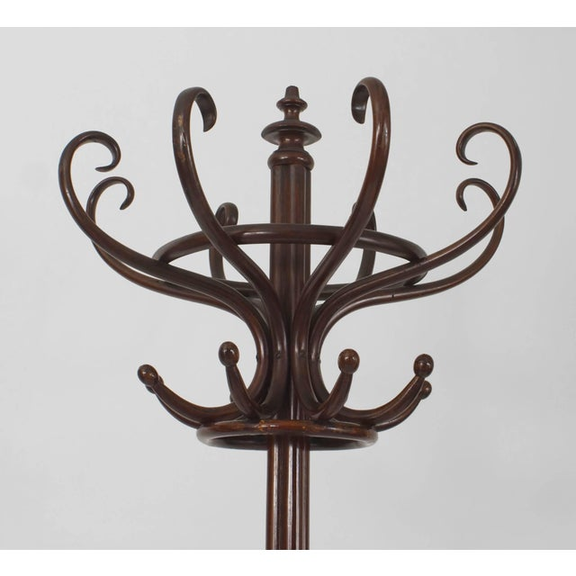 Austrian bentwood (1st quarter of the 20th century) beechwood stained mahogany hatrack with eight scroll hat supports and...
