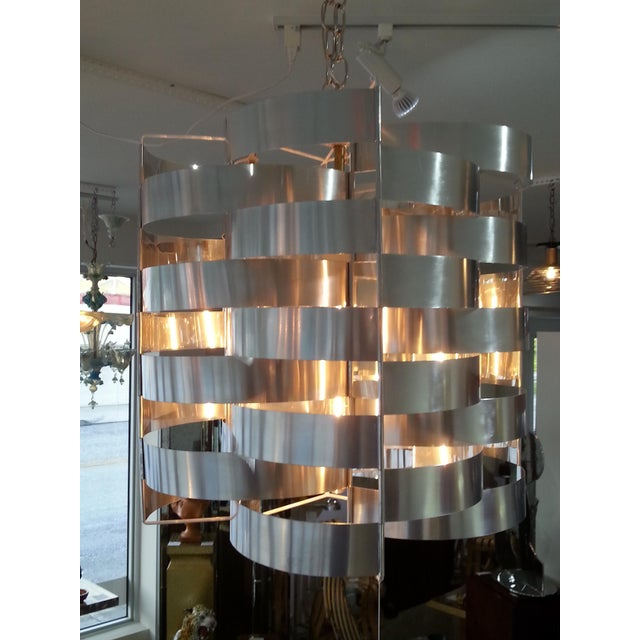 This stylish and chic chandelier is by the designer Max Sauze and dates to the 1970s. The piece is fabricated in polished...