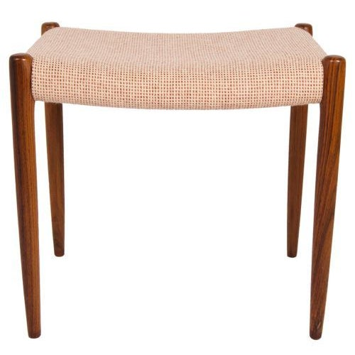 Tall Danish Modern ottoman designed by Niels Møller with original upholstery. We have a matching pair! -- Please inquire....