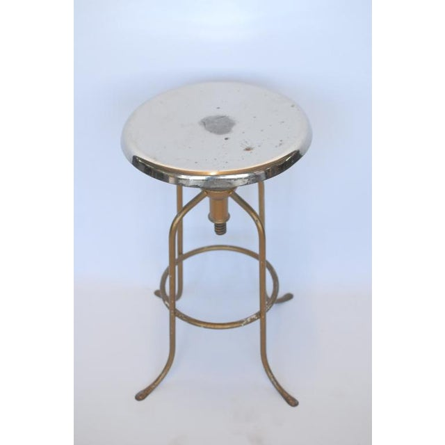 Great simple 1940's American polished steel stool. This piece would look greta in an industrial room setting.