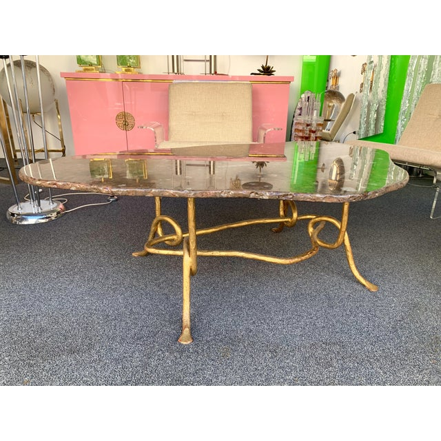 Freeform coffee or cocktail low table by the workshop Christian Pinguaud. Wrought iron gold leaf, like hammered bronze,...
