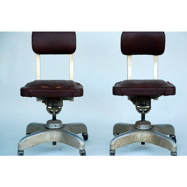 Pair of Aged Industrial Office Swivel Chairs