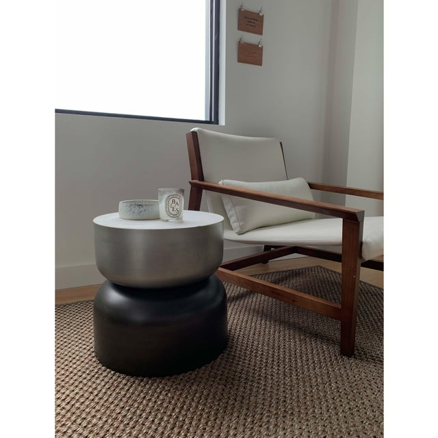 Round, space-age style side table from CB2. In immaculate, like-new condition. Solid marble top and spun metal base that...
