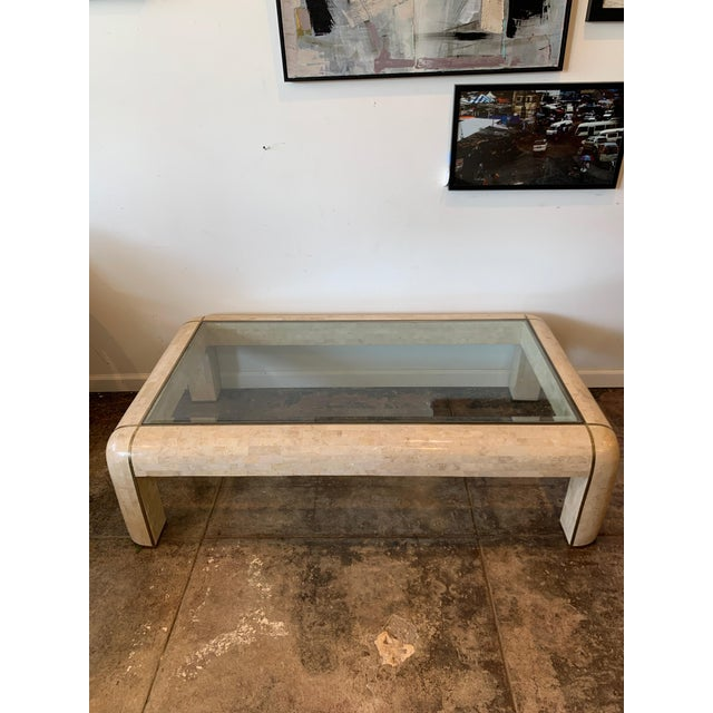 High quality heavy hand crafted tessellated marble veneer coffee table, with brass trim and a thick beveled inset glass...