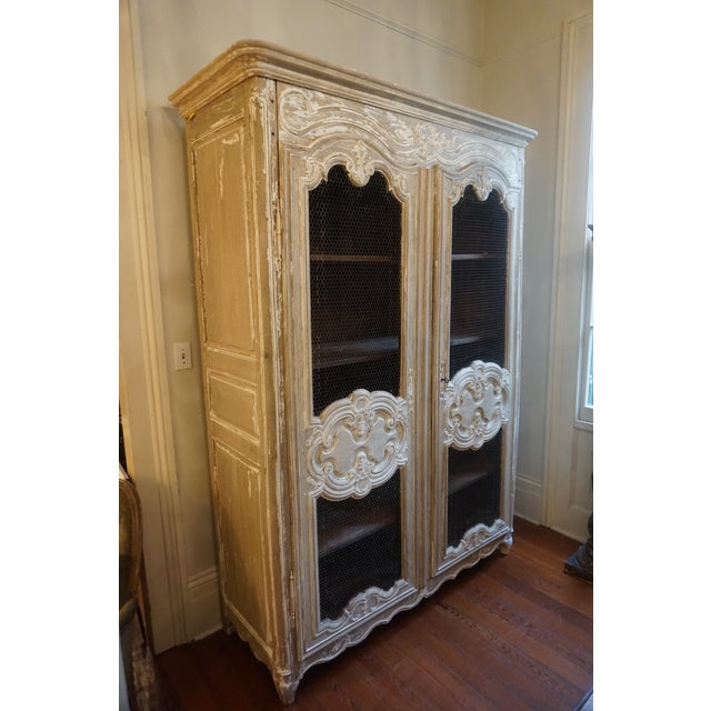 Early 19th Century Oak bleached Armoire with chicken wire doors.