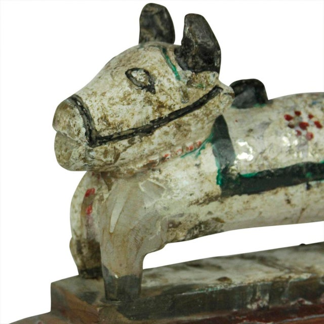 Antique hand-carved wood Nandi bull with original painted finish. Age wear.