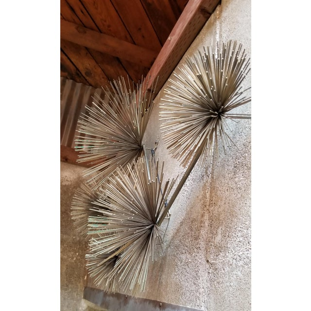 A vintage brutalist wall sculpture Pom Pom or Urchin by Curtis Jere. Signed C. Jere and dated 1979. Sculpture may be hung...